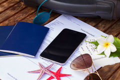 Travel documents. Suitcase, travel documents with black smartphone stock image