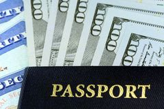 Travel Documents - USA Passport with American Currency Stock Photos