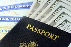 Travel Documents - USA Passport with American Currency. United States passport with one hundred dollar bills Royalty Free Stock Images