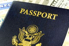 Travel Documents - USA Passport with American Currency Royalty Free Stock Photography