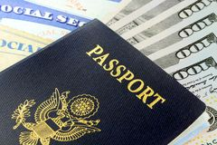 Travel Documents - USA Passport with American Currency Stock Photo