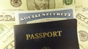 Travel Documents - USA Passport with American Currency. United States travel passport and social security card with fifty dollar bills stock footage