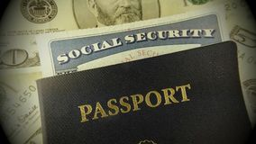 Travel Documents - USA Passport with American Currency. United States travel passport and social security card with fifty dollar bills stock video