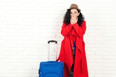 Travel dream. Girl can`t believe that won a trip. Stylish woman ready to travelling. Girl with suitcase over white wall, copy royalty free stock image
