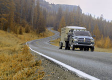 Travel Driving. Driving by the mountains with camper royalty free stock images