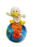 Travel duck. Photo of a cheeky little duck sitting on a globe depicting travel Stock Photo