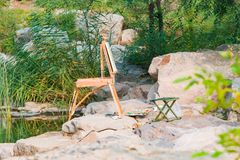 Travel easel in the park. An artist`s travel easel all set up ready to go Royalty Free Stock Photo