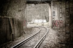 Travel by empty train tracks stock image