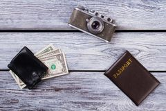 Travel essentials flat lay. Vintage camera, passport and wallet with money, top view Royalty Free Stock Photography