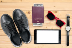 Travel essentials. Essentials for travelling collage of a young modern person Royalty Free Stock Image