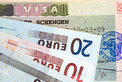 Travel in Europe:. Schengen Visa and euro banknotes Stock Photo