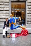 Travel Europe - Florence, Italy. FLORENCE, ITALY - MARCH 27: A Asian tourist taking a photo with Genie and the Magic Lamp street performer in Florence, Italy Stock Photo