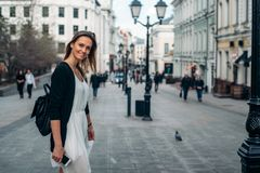 Travel in Europe. Girl is walking along the old street. Traveler walks in Moscow Royalty Free Stock Photo