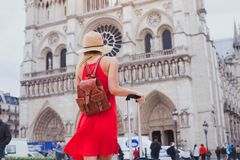 Tourist looking at Notre Dame cathedral in Paris, France. Travel in Europe, gothic architecture of catholic church, tourist looking at Notre Dame cathedral in royalty free stock photography