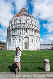 Travel Europe - The Pisa Cathedral, Pisa, Italy. A happy woman taking photo with the Pisa Cathedral in Pisa, Italy Royalty Free Stock Photography