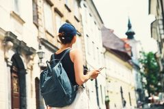 Woman tourist with backpack on street of Ljubljana, Slovenia. Royalty Free Stock Photography