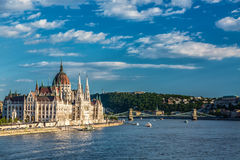 Travel and european tourism concept. Parliament and riverside in Budapest Hungary with sightseeing ships during summer sunny day w Royalty Free Stock Images