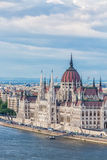 Travel and european tourism concept. Parliament and riverside in Budapest Hungary during summer sunny day with blue sky and clouds royalty free stock photo