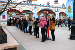 Travel in Everland, Korea. EVERLAND, YONGIN, KOREA - NOVEMBER 26 : The unidentified group of tourists are queuing and be happy at the entrance way on November 26 royalty free stock photos