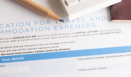Travel expenses form with passport and pencil. On table royalty free stock images