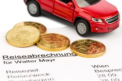 Travel expenses. A settlement of travel expenses with car and euro coins stock photo