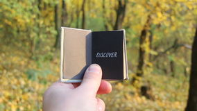 Travel explore discover idea. Hand holding a book with the inscription stock video footage