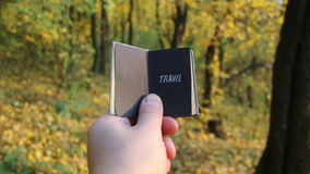 Travel Explore Wanderlust Trip Adventure idea. Hand holding a book with the inscription Travel stock footage