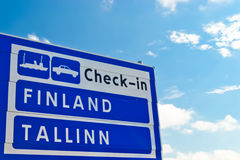 Travel Finland Tallinn. Sign showing the way to the ferry Royalty Free Stock Photography