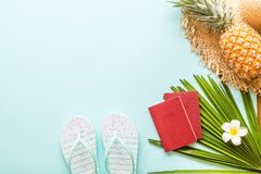Travel flat lay items: fresh pineapple, beach slippers, tropical flower and palm leaf. Place for text. Top view. Summer concept stock photos