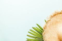 Travel flat lay items: straw hat and palm leaf. Place for text. Top view. Summer concept stock photos