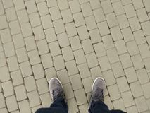 Travel foot of man standing on brick background.  Royalty Free Stock Photos