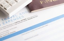 Travel form with calculator and passport. On the table royalty free stock photography