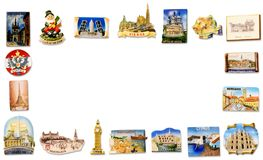 Travel fridge magnet frame. A collection of fridge magnets bought from different visited countries arranged as a horizontal frame stock photo