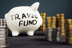 Travel fund. Piggy bank and coins. Money for vacation. Stock Images