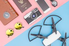 Travel Gadget Drone and other objects on blue and pink. Background Stock Image