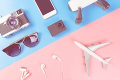 Travel Gadget and objects on blue and pink background. Top view Stock Image