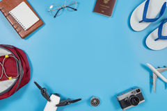 Travel gadgets and accessories on blue copy space Royalty Free Stock Photography