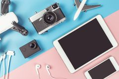 Travel gadgets on blue and pink background for travel concept. Travel gadgets flatlay on blue and pink background for travel concept Stock Photo