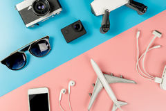 Travel Gadgets on blue and pink pastel. Background Stock Photo