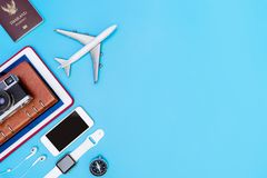 Travel gadgets and objects on blue. Copy space Royalty Free Stock Photos