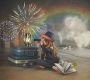 Travel Girl Looking at Fireworks on Surreal Beach. A little girl at the beach is looking through a magnifying telescope at fireworks in the sky with a map and royalty free stock images