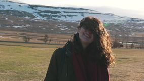 Travel girl in nature smiles in sunlight.  stock video