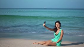 Travel girl talking to the phone near the sea stock footage