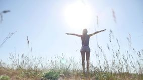 Travel. Girl Young woman arms raised enjoying the fresh air in grass nature sunlight. Travel. Girl Young woman arms raised enjoying fresh air in grass nature stock video footage