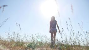 Travel. Girl Young woman arms raised enjoying the fresh air in grass sunlight nature. Travel. Girl Young woman arms raised enjoying fresh air in grass sunlight stock footage