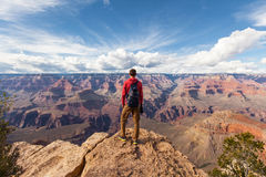 Travel in Grand Canyon, man Hiker with backpack enjoying view, USA.  stock photos