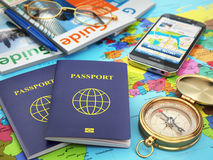 Travel guide concept. Passport, compass, guide books, mobile phone Stock Photo