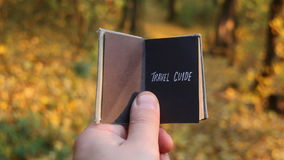 Travel guide. Text and Book. Hand holding a book with text Travel guide stock footage