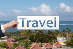 Travel. Hand holding poster with travel text Stock Photography