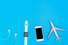Travel handheld accessories objects on blue. Copy space Stock Photos